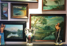 Thrift store painting collection in her dining room